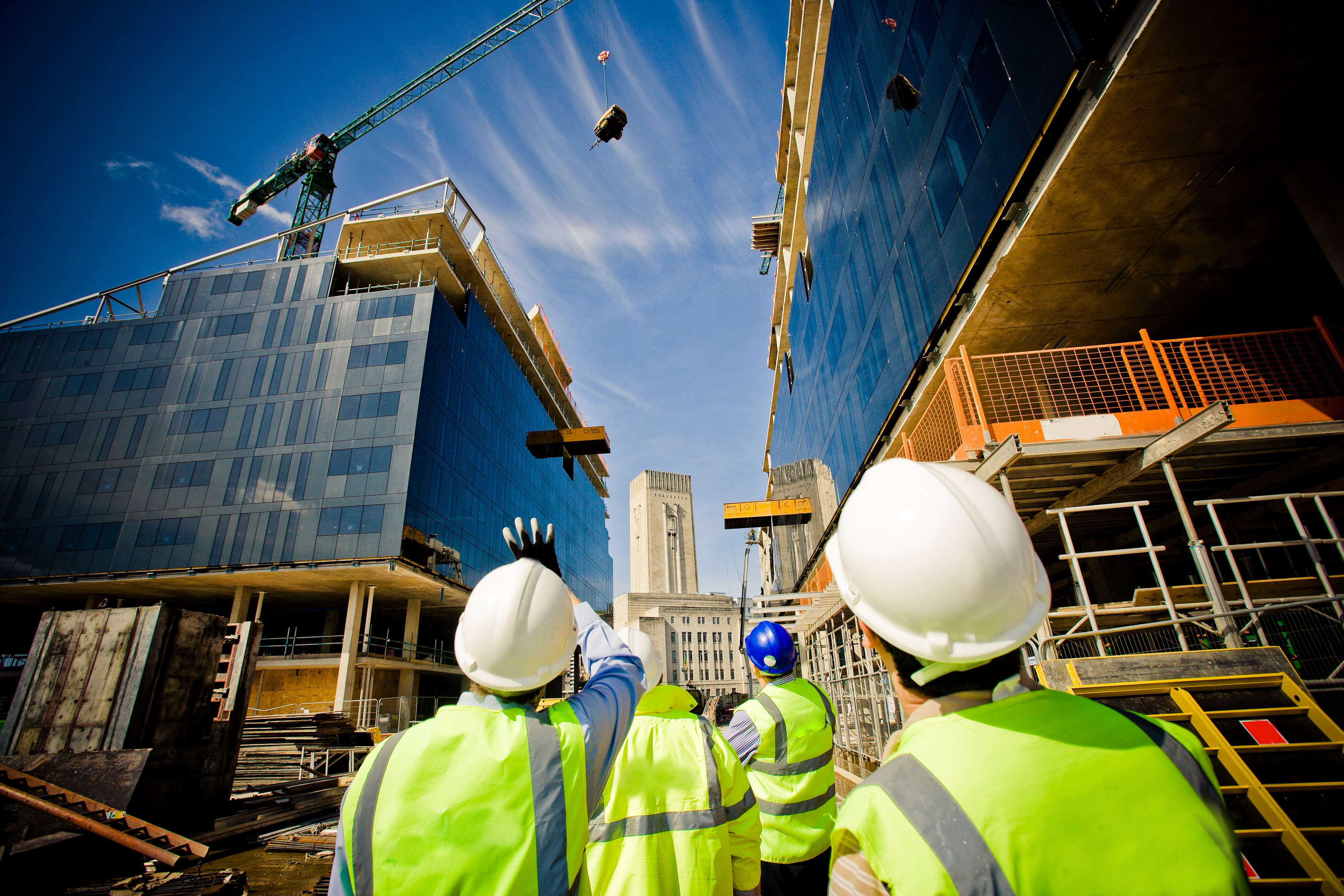 building-under-construction-with-workers-shutterstock_57862405